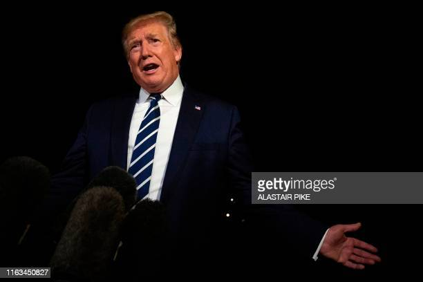 US President Donald Trump gestures as he speaks to the press while departing the White House in Washington DC on August 23 for the G7 Summit in France