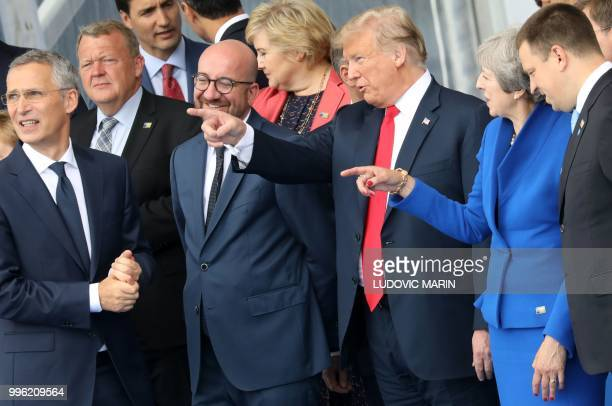 President Donald Trump gestures as he speaks with Britain's Prime Minister Theresa May Belgium's Prime Minister Charles Michel , NATO Secretary...