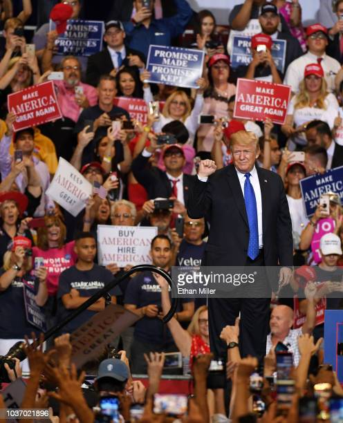 S President Donald Trump gestures as he walks onstage for a campaign rally at the Las Vegas Convention Center on September 20 2018 in Las Vegas...