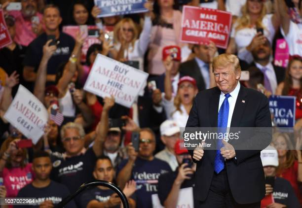 President Donald Trump gestures as he walks onstage for a campaign rally at the Las Vegas Convention Center on September 20, 2018 in Las Vegas,...