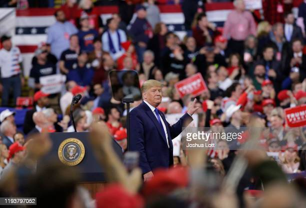 S President Donald Trump gestures as protesters yell during a rally on January 14 2020 at UWMilwaukee Panther Arena in Milwaukee Wisconsin Trump who...