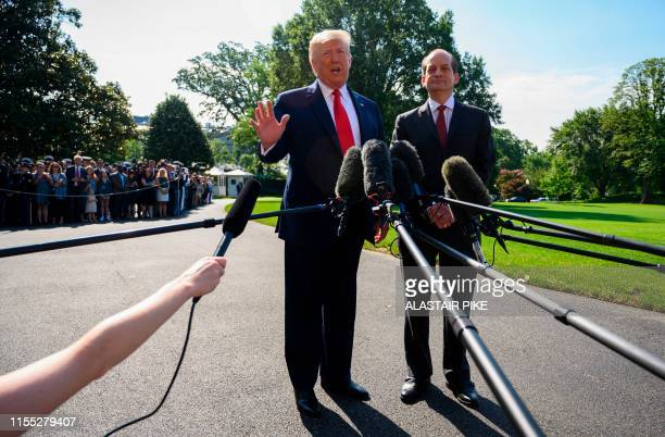 US President Donald Trump gestures as US Labor Secretary Alexander Acosta looks as they speak to the media on July 12 2019 at the White House in...