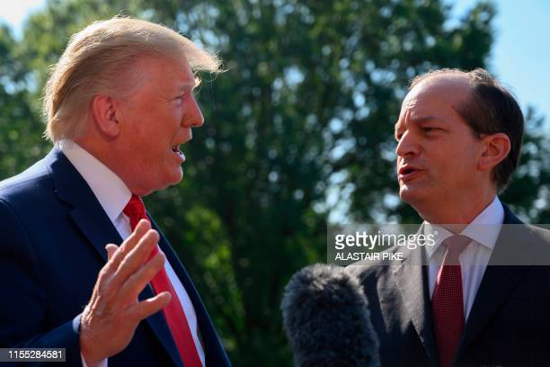 US President Donald Trump gestures as US Labor Secretary Alexander Acosta looks on as they speak to the media on July 12 2019 at the White House in...