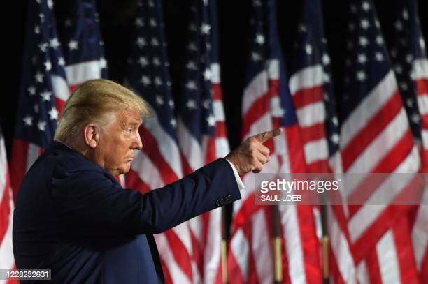 President Donald Trump gestures at the conclusion of the the final day of the Republican National Convention from the South Lawn of the White House...