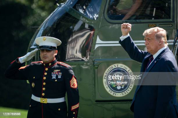 President Donald Trump gestures before boarding Marine One on the South Lawn of the White House on September 29, 2020 in Washington, DC. President...