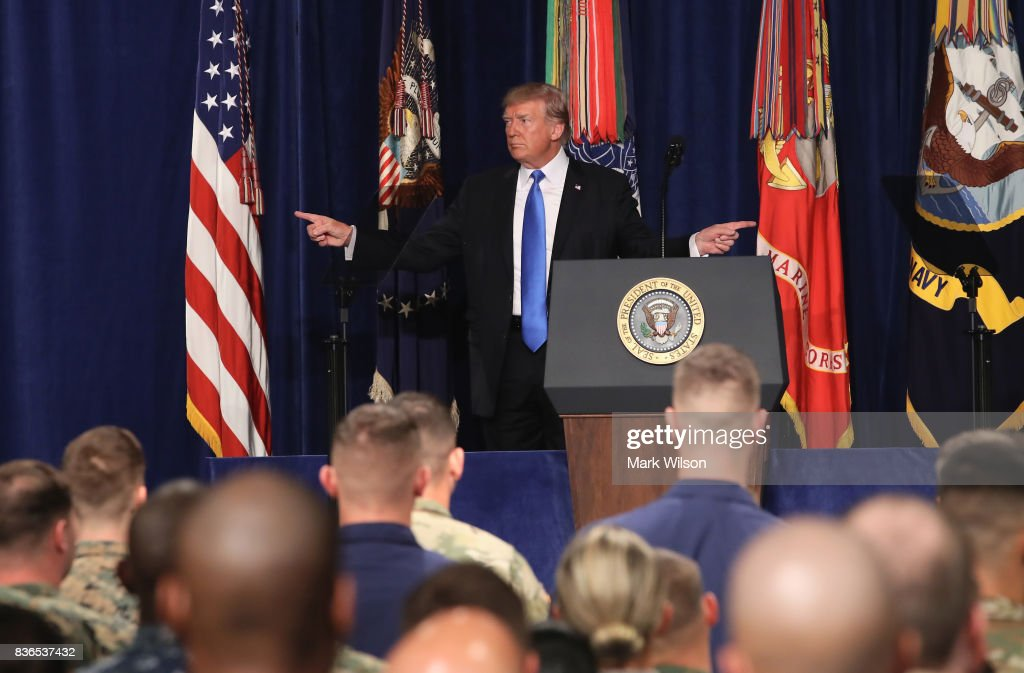 U.S. President Donald Trump gestures before delivering remarks on Americas military involvement in Afghanistan at the Fort Myer military base on August 21, 2017 in Arlington, Virginia. Trump was expected to announce a modest increase in troop levels in Afghanistan, the result of a growing concern by the Pentagon over setbacks on the battlefield for the Afghan military against Taliban and al-Qaeda forces.