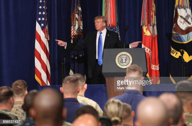 S President Donald Trump gestures before delivering remarks on Americas military involvement in Afghanistan at the Fort Myer military base on August...