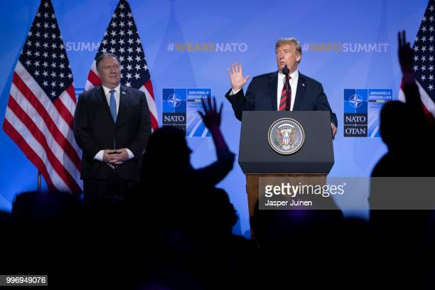 S President Donald Trump gestures besides US Secretary of State Mike Pompeo during a news conference at the 2018 NATO Summit at NATO headquarters on...