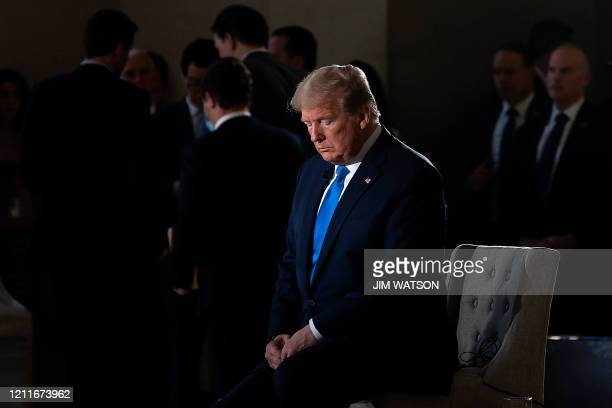 US President Donald Trump gestures during a commercial break of a Fox News virtual town hall America Together Returning to Work event from the...
