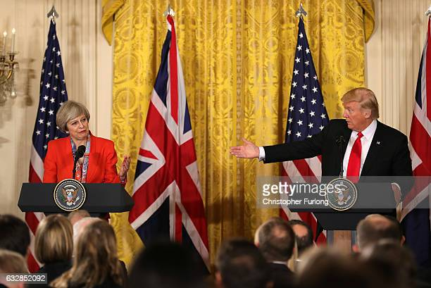 S President Donald Trump gestures during a joint press conference with British Prime Minister Theresa May in The East Room at The White House on...