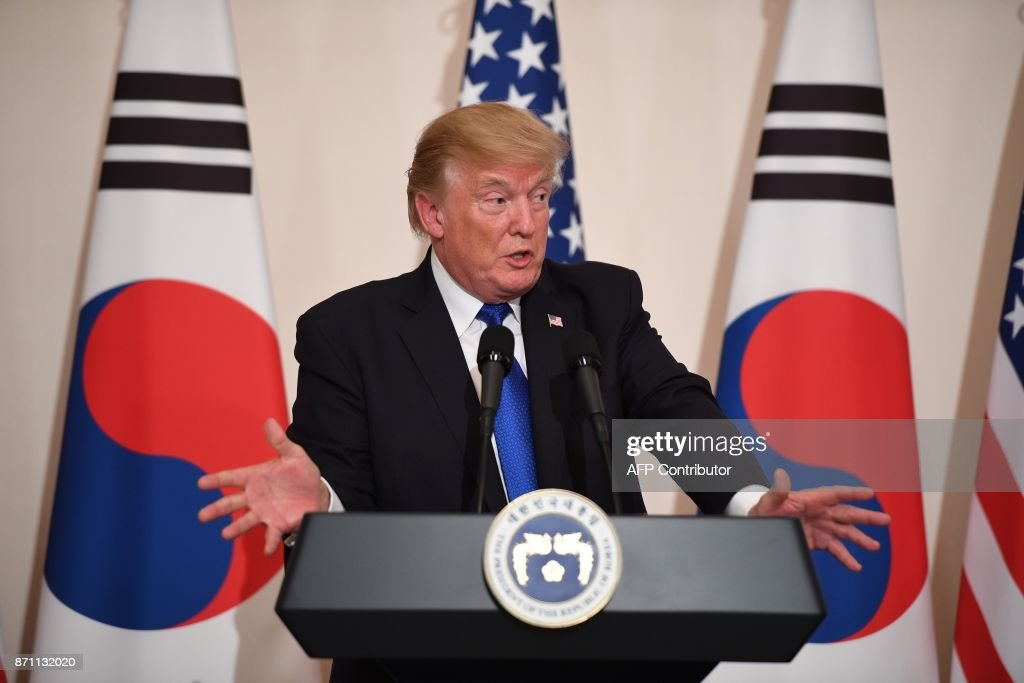 US President Donald Trump gestures during a joint press conference with South Korea's President Moon Jae-In at the presidential Blue House in Seoul on November 7, 2017. US President Donald Trump arrived in Seoul on November 7 vowing to 'figure it all out' with his South Korean counterpart Moon Jae-In, despite the two allies' differences on how to deal with the nuclear-armed North. / AFP PHOTO / Jim WATSON