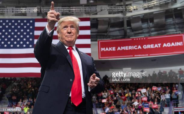 US President Donald Trump gestures during a Make America Great Again rally in Green Bay Wisconsin April 27 2019