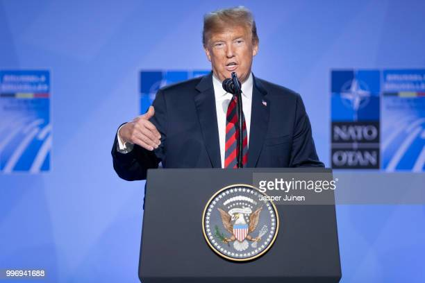 S President Donald Trump gestures during a news conference at the 2018 NATO Summit at NATO headquarters on July 12 2018 in Brussels Belgium Leaders...