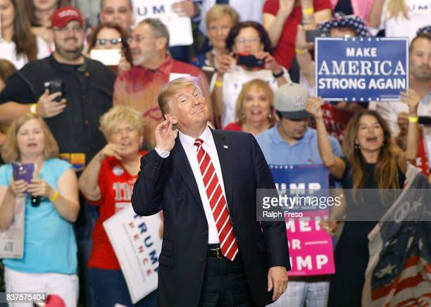 S President Donald Trump gestures during a rally at the Phoenix Convention Center on August 22 2017 in Phoenix Arizona An earlier statement by the...