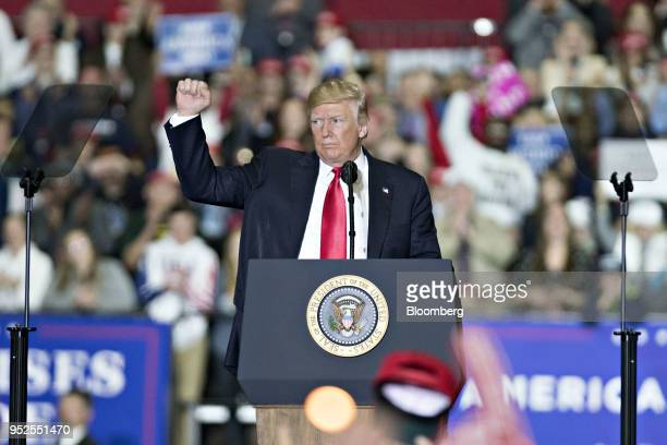 US President Donald Trump gestures during a rally in Washington Michigan US on Saturday April 28 2018 Trumptook on most of his usual targets at a...