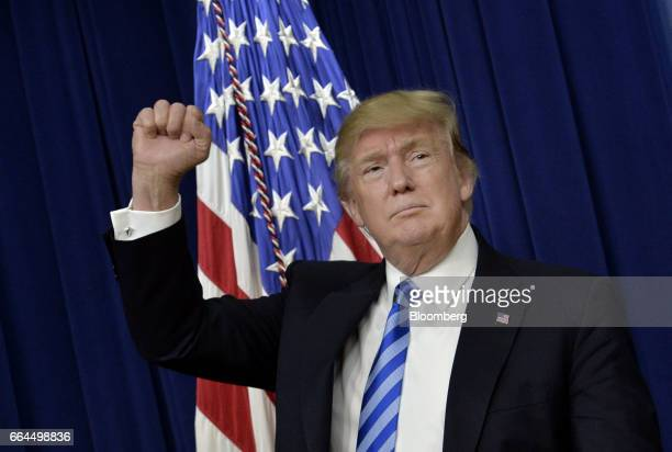 US President Donald Trump gestures during a town hall meeting with executives on the America business climate in the South Court Auditorium of the...