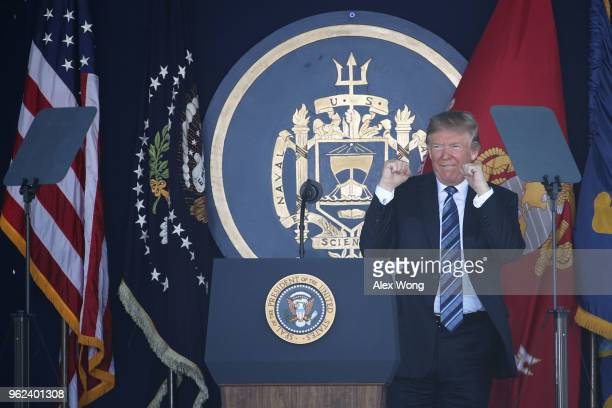 S President Donald Trump gestures during a US Naval Academy graduation ceremony at the NavyMarine Corps Memorial Stadium May 25 2018 in Annapolis...