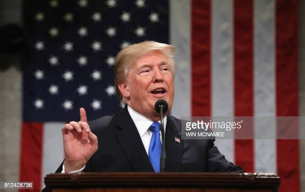 US President Donald Trump gestures during the State of the Union address in the chamber of the US House of Representatives in Washington DC on...