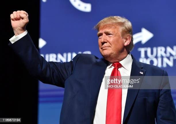US President Donald Trump gestures during the Turning Point USA Student Action Summit at the Palm Beach County Convention Center in West Palm Beach...