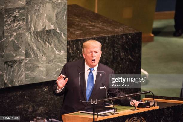 President Donald Trump gestures in a characteristic fashion as he addresses the 72nd UN General Assembly
