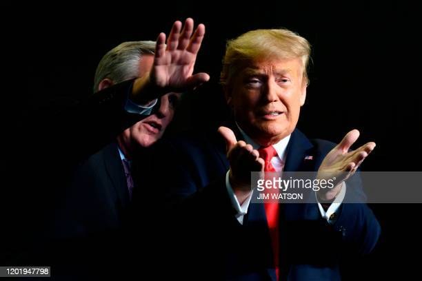 President Donald Trump gestures next to US Congressman Kevin McCarthy as they deliver remarks to Rural Stakeholders on California Water Accessibility...