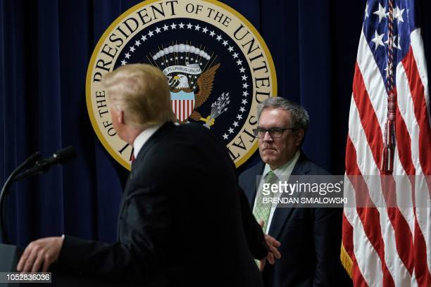 US President Donald Trump gestures to EPA Acting Administrator Andrew Wheeler while talking to people from Hawaii Alaska and California during an...