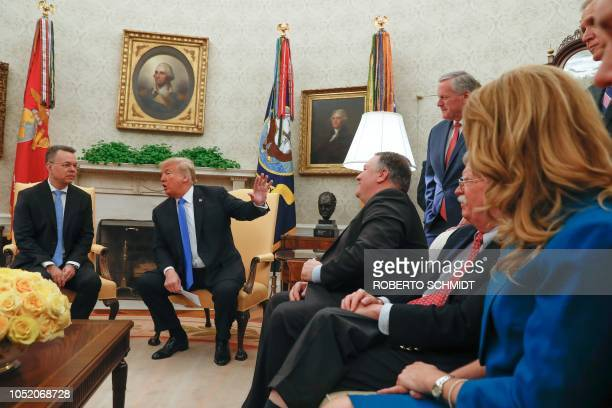 US President Donald Trump gestures to members of his cabinet and other high US government officials as he speaks to freed American pastor Andrew...
