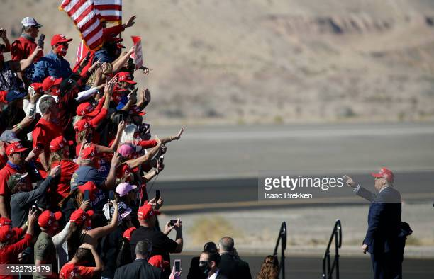 President Donald Trump gestures to supporters following a campaign rally on October 28, 2020 in Bullhead City, Arizona. With less than a week until...