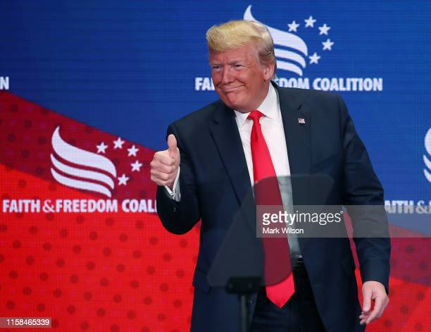 S President Donald Trump gestures to the audience after speaking at the Faith Freedom Coalition 2019 Road To Majority Policy Conference at the...