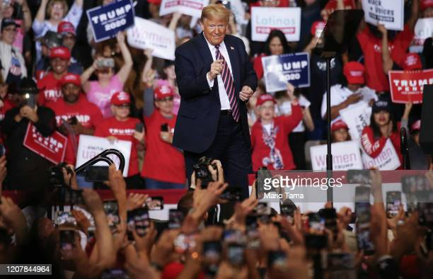 President Donald Trump gestures to the crowd at a campaign rally at Las Vegas Convention Center on February 21 2020 in Las Vegas Nevada The upcoming...