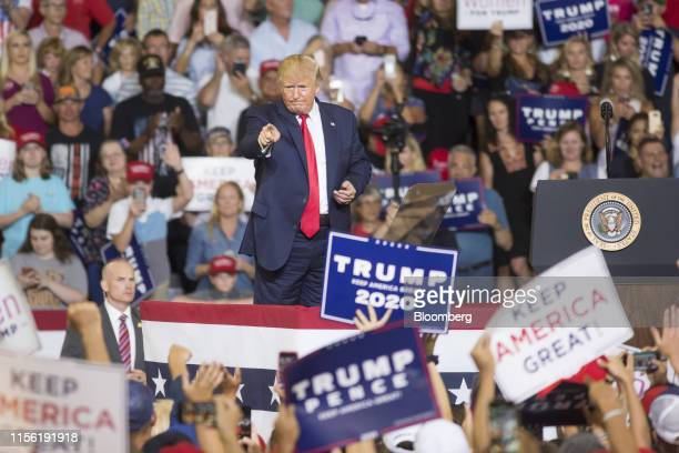 US President Donald Trump gestures to the crowd during a rally in Greenville North Carolina US on Wednesday July 17 2019 Trumpissued his most...