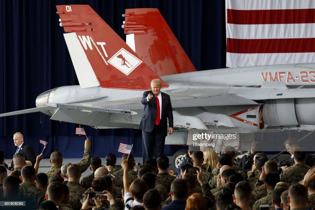 U.S. President Donald Trump gestures to the crowd during an event at Marine Corps Air Station Miramar in San Diego, California, U.S., on Tuesday, March 13, 2018. Trump traveled to opposition territory -- California -- to fire up support for a wall along the U.S.-Mexico border, a project that has encountered resistance in Congress. Photographer: Patrick T. Fallon/Bloomberg via Getty Images