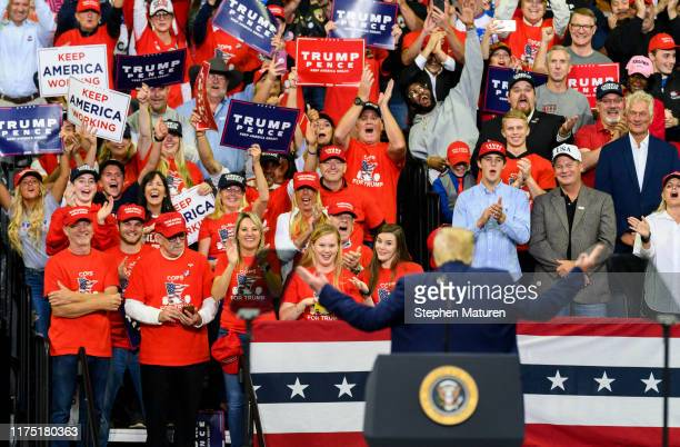 President Donald Trump gestures to the crowd while on stage during a campaign rally at the Target Center on October 10, 2019 in Minneapolis,...