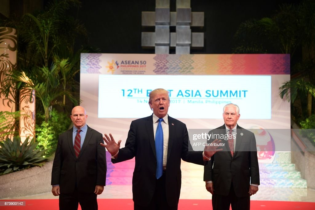 US President Donald Trump (C) gestures to the press as US National Security Advisor HR McMaster (L) and US Secretary of State Rex Tillerson look on after attending the 31st Association of Southeast Asian Nations (ASEAN) Summit in Manila on November 14, 2017. The US president is in the Philippines with leaders of 18 other nations for two days of summits, the final leg of a headline-grabbing Asian tour dominated by the North Korean nuclear crisis. /