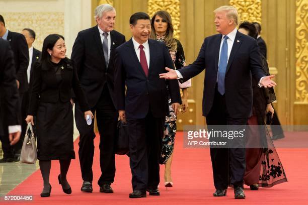 US President Donald Trump gestures toward China's President Xi Jinping as US First Lady Melania Trump is seen in the background in the Great Hall of...