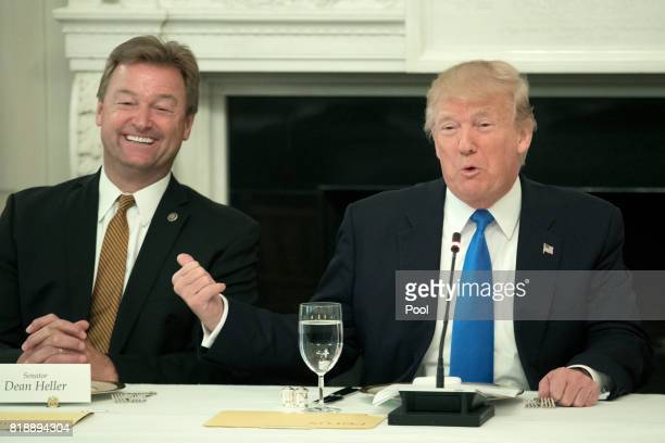 President Donald Trump gestures towards Sen. Dean Heller while delivering remarks on health care and Republicans' inability thus far to replace or...