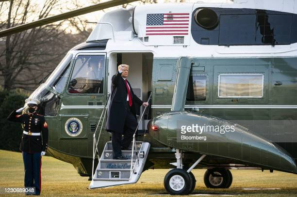 President Donald Trump gestures while boarding Marine One on the South Lawn of the White House in Washington, D.C., U.S., on Wednesday, Jan. 20,...