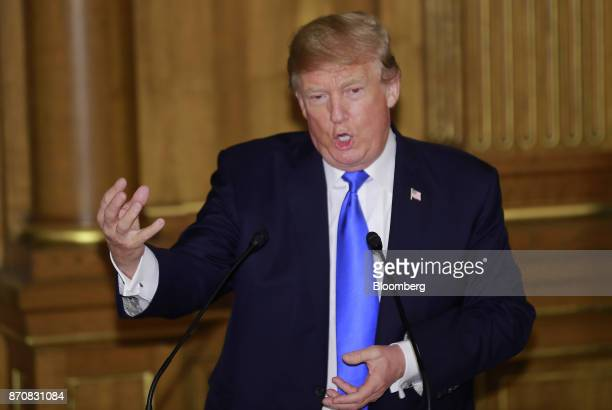 US President Donald Trump gestures while delivering a speech during a state banquet at Akasaka Palace in Tokyo Japan on Monday Nov 6 2017 Trump urged...
