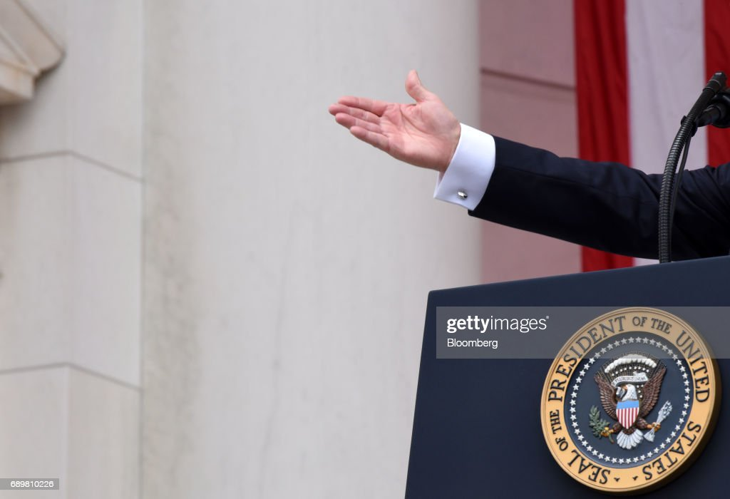 U.S. President Donald Trump gestures while speaking at a wreath laying ceremony at the Tomb of the Unknown Soldier at Arlington National Cemetery in Arlington, Virginia, U.S., on Monday, May 29, 2017. On Memorial Day, Trump visited Arlington National Cemetery to honor the memory of fallen service men and women. Photographer: Olivier Douliery/Pool via Bloomberg