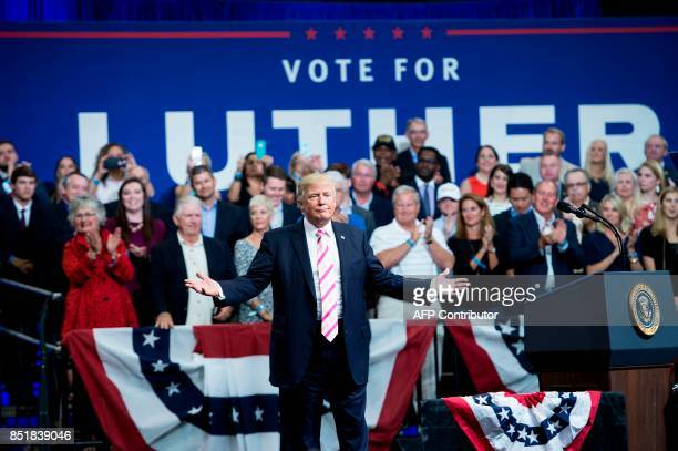 US President Donald Trump gestures while speaking during rally for Alabama state Republican Senator Luther Strange at the Von Braun Civic Center...