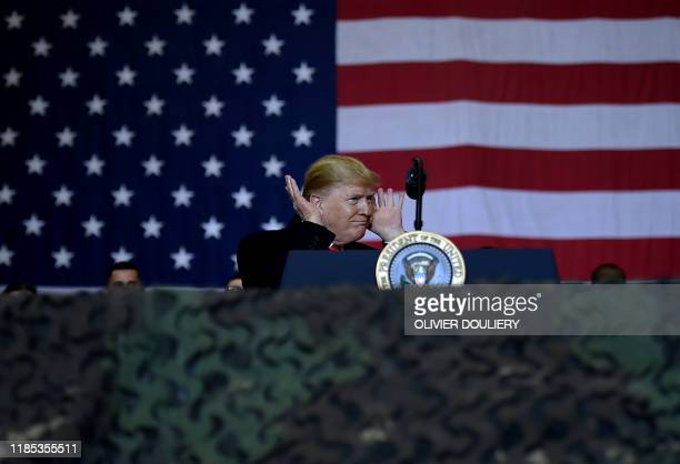 President Donald Trump gestures while speaking to the troops during a surprise Thanksgiving day visit at Bagram Air Field, on November 28, 2019 in...