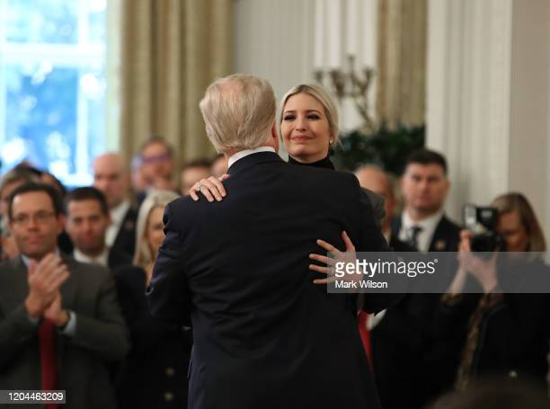 S President Donald Trump gets a hug from his daughter White House advisor Ivanka Trump one day after the US Senate acquitted him on two articles of...