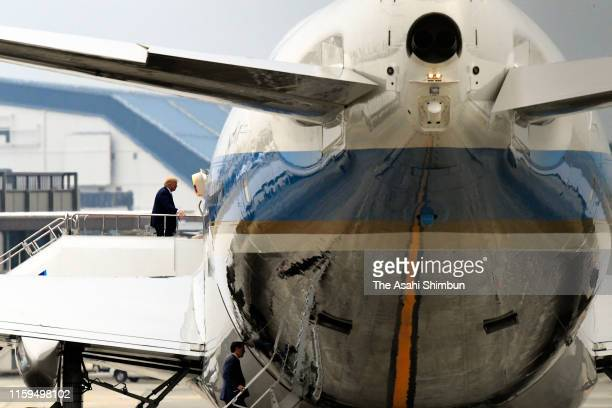 President Donald Trump gets aboard the Air Force One after the second day of the G20 summit at Osaka International Airport on June 29, 2019 in...