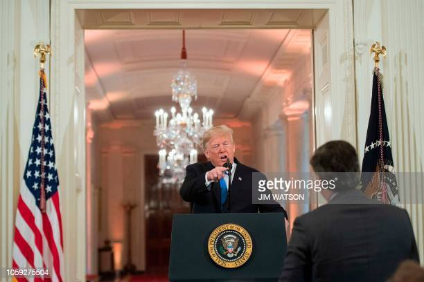 US President Donald Trump gets into a heated exchange with CNN chief White House correspondent Jim Acosta during a postelection press conference in...