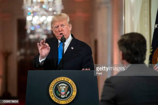 US President Donald Trump gets into an exchange with CNN reporter Jim Acosta during a news conference a day after the midterm elections on November 7...