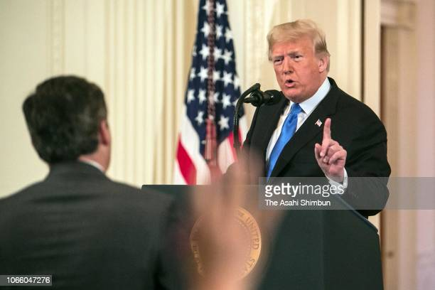 US President Donald Trump gets into an exchange with Jim Acosta of CNN after giving remarks a day after the midterm elections on November 7 2018 in...
