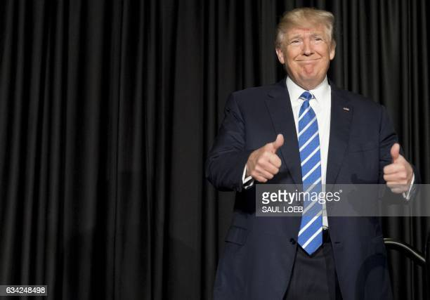 US President Donald Trump gives a double thumbsup as he arrives to speak at the Major Cities Chiefs Association and Major County Sheriff's...