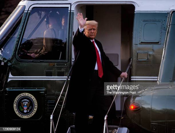 January 20: President Donald Trump gives a final wave as he boards Marine One as he and First Lady Melania Trump depart the White House for the last...