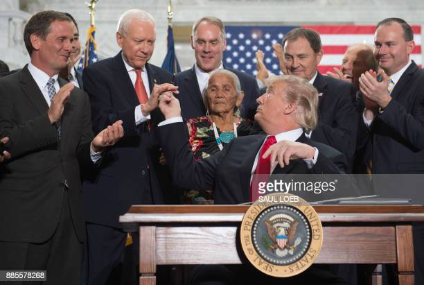 US President Donald Trump gives a pen to US Senator Orrin Hatch Republican of Utah after signing a Presidential Proclamation shrinking Bears Ears and...