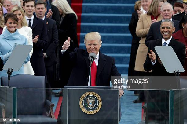 President Donald Trump gives a thumbs up after his inauguration on the West Front of the US Capitol on January 20 2017 in Washington DC In today's...